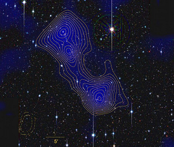 The mass distribution (blue) and significance of overdensity (contours) of the two clusters and the connecting filament, constructed from weak lensing observations. It is shown on top of an optical image of the region. Courtesy: KIPAC