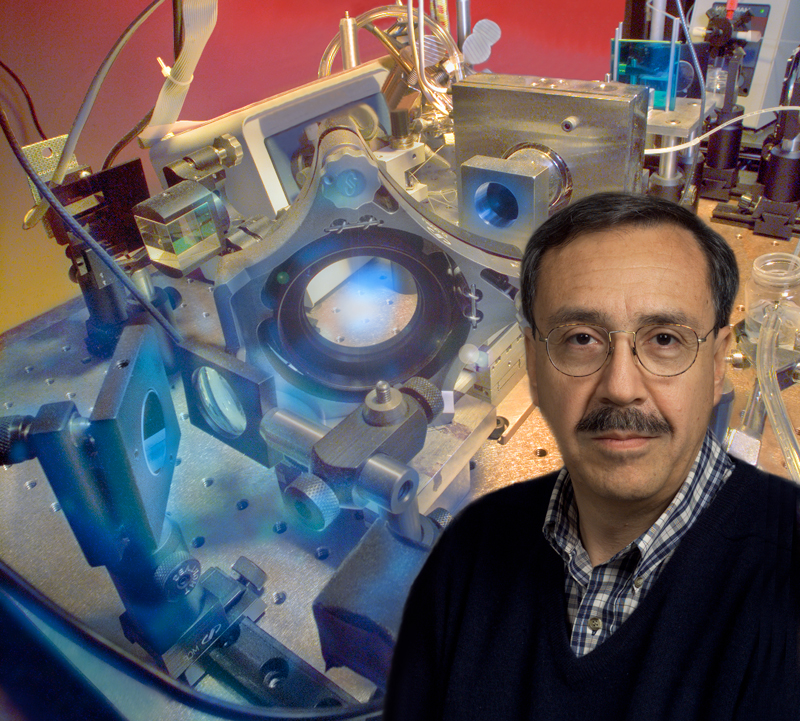 Biophysicist Carlos Bustamante with the optical tweezers setup used to measure nanomotors strength. (Credit: Lawrence Berkeley National Lab - Roy Kaltschmidt, photographer)